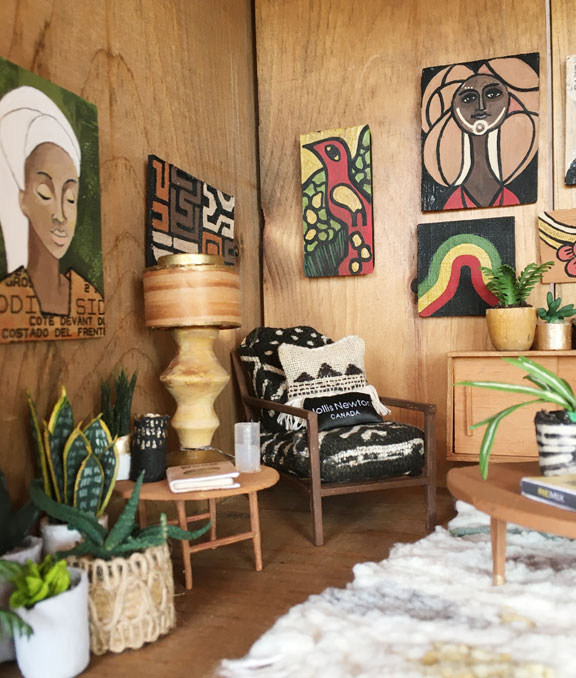 detail of miniature living room suite with african and caribbean decor
