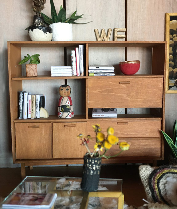 miniature mid-century modern wall unit with books