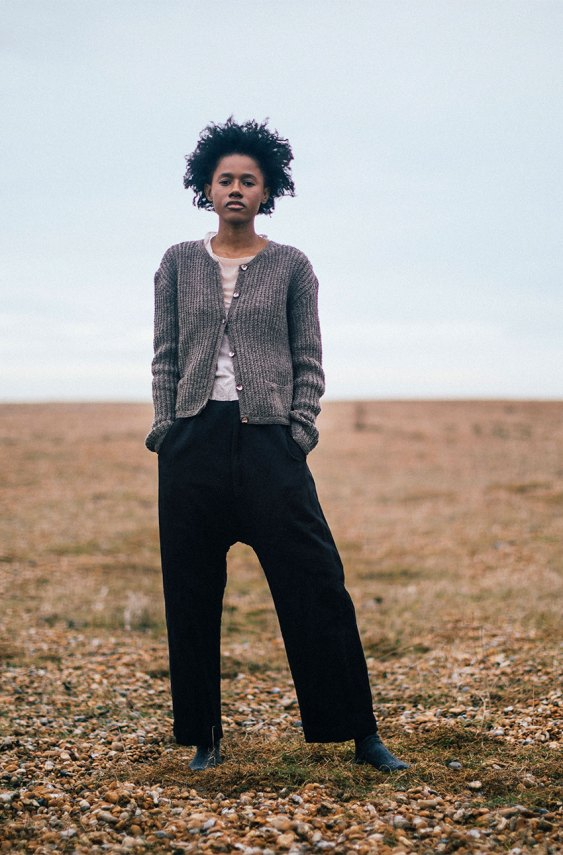 model wearing clay pants