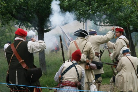 A small detachment of French troops is cornered by the British and their Native American allies