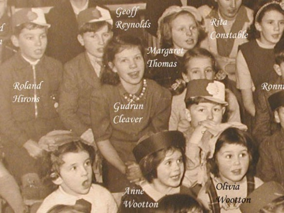 Gudrun can be seen in this 1953 photo taken during a Christmas Party in the school. The children are watching a conjuror!