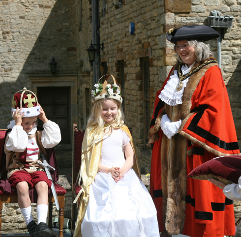 The May Queen is crowned by the Brackley Town Mayor