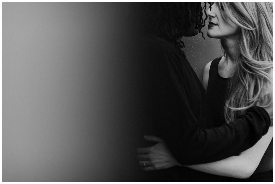 black-and-white-image-of-engaged-couple-about-to-kiss