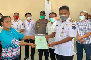 Serahkan 1.400 Sertifikat Tanah Program PTSL untuk Eks Transmigran di Bitung, Gubernur Olly: Tanahnya Jangan Dijual