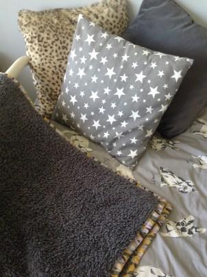 Cushions and edge bound blanket
