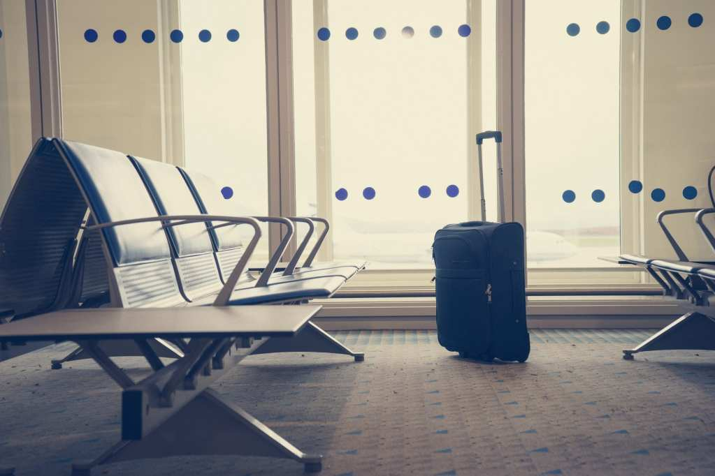 Traveling luggage in airport terminal. Suitcases in airport depa