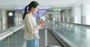 Woman use of smart phone in the airport
