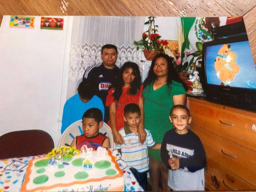 Reinaldo Rojano and Zenaida Morales with three of their children and two nephews.