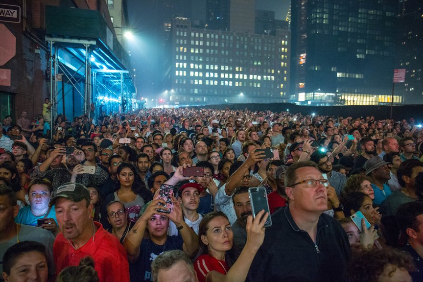 A photo of people watching fireworks from the FDR Drive