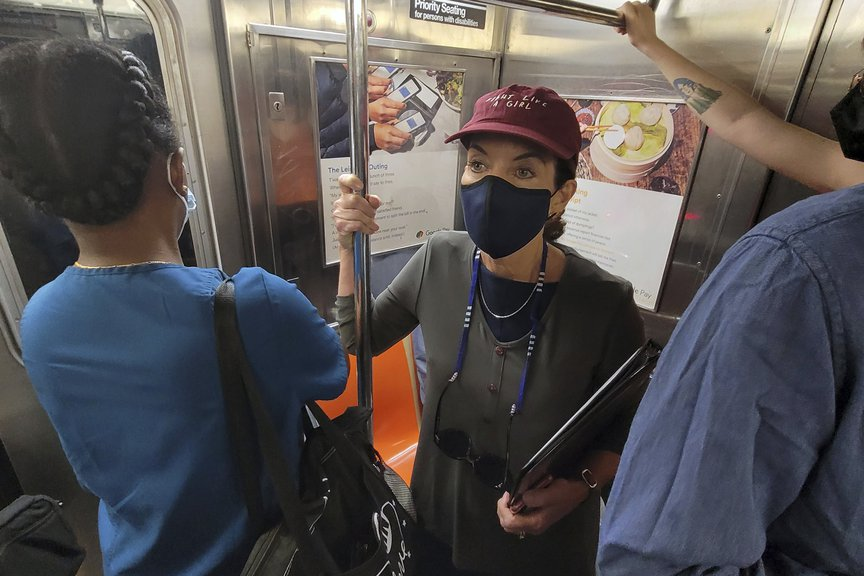 """New York Lieutenant Governor Kathy Hochul rides a NYC subway car on August 4th wearing a mask and a baseball hat that says """"Fight Like A Girl."""""""