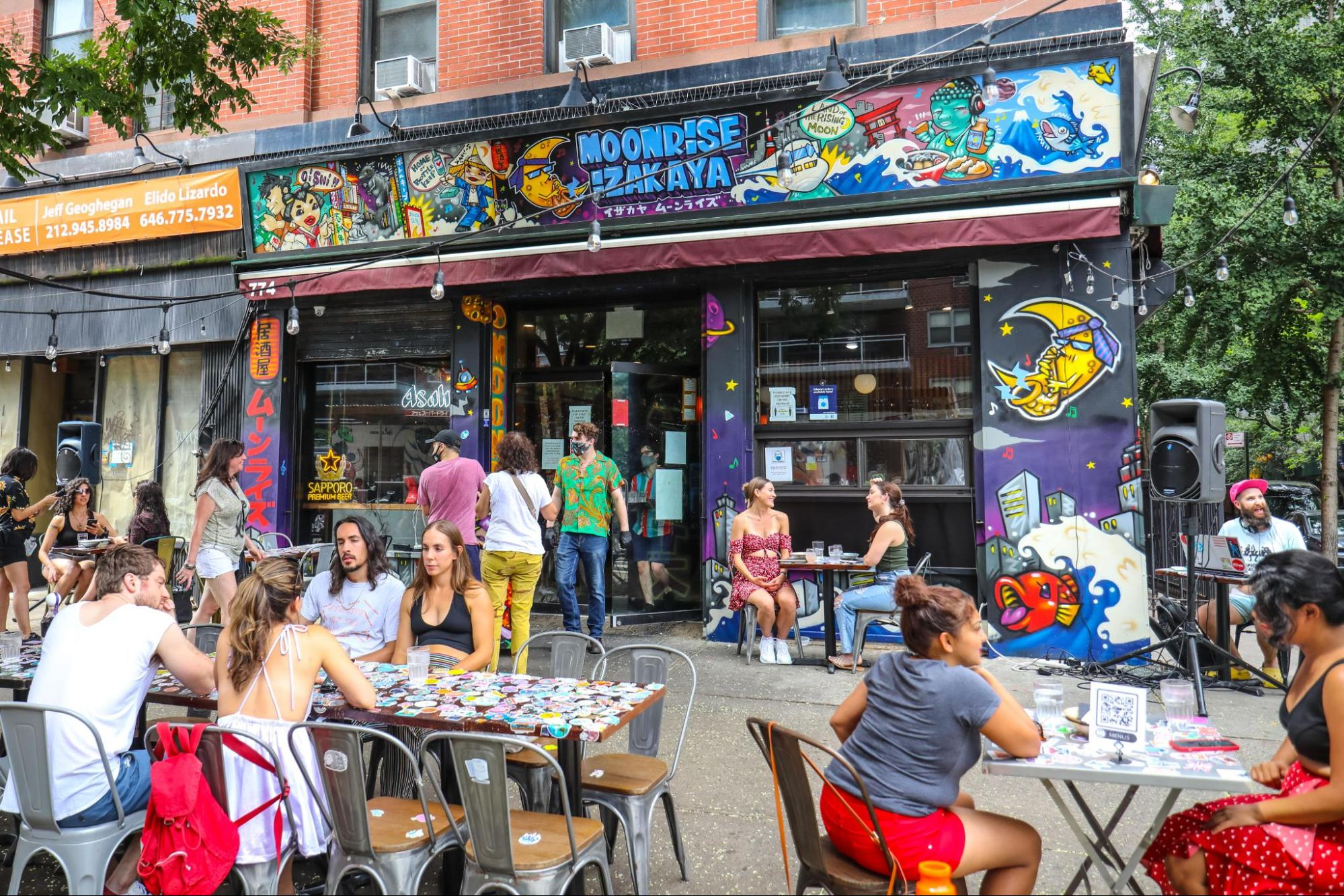 diners sitting at tables outside moonrise izakaya