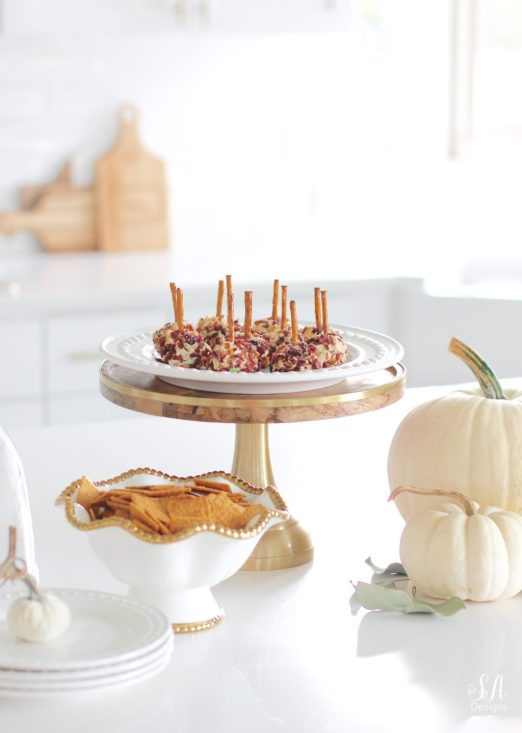 fall recipes, fall appetizers, cheese ball recipe, pink kitchenaid hand mixer, pink kitchenaid mixing bowls, white kitchen, brass pendant lights with crystals, wood and brass cake stand with dome, white dishes, white pumpkins, white interiors