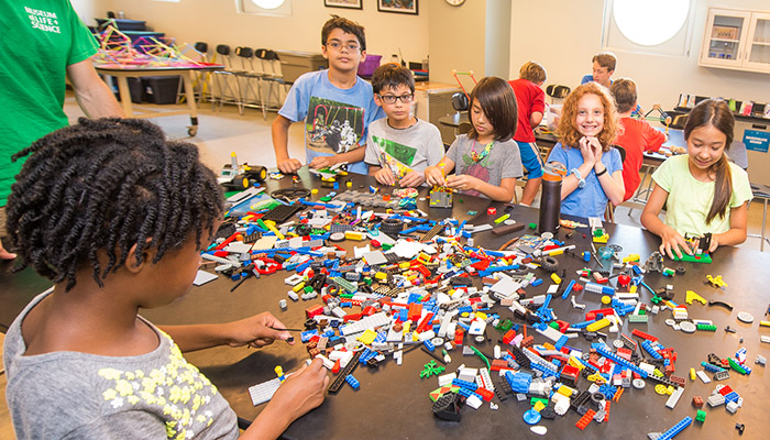 Campers play with LEGOs