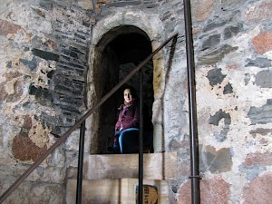 The author in the porter's nook at Iona Abbey.