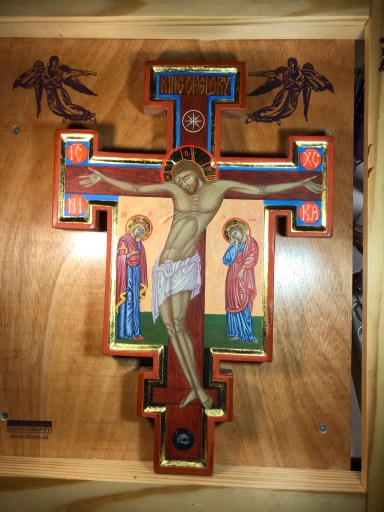 Image of a crucifix icon with rich jewel tones and gilding, with Christ crucified and the Mother of God weeping below him on the left and John the Beloved disciple mourning on the right. A skull is beneath Jesus' feet