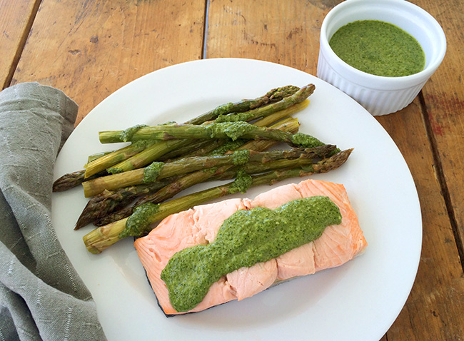 Poached salmon with roasted asparagus and cilantro-pumpkin seed pesto