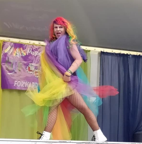 With her introduction, including her rainbow outfit and high energy, this drag queen shows the audience that crazy moves in high heels are not needed to make a drag performance lovable and exciting.