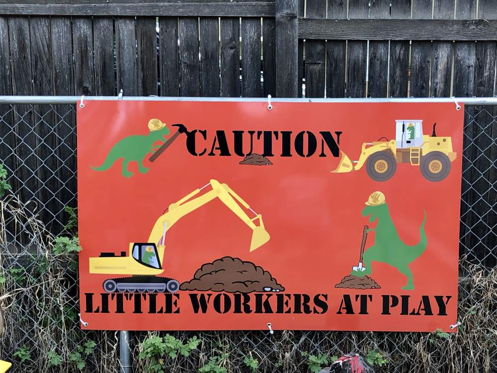 luccas workers at plan sign - luccas-workers-at-plan-sign