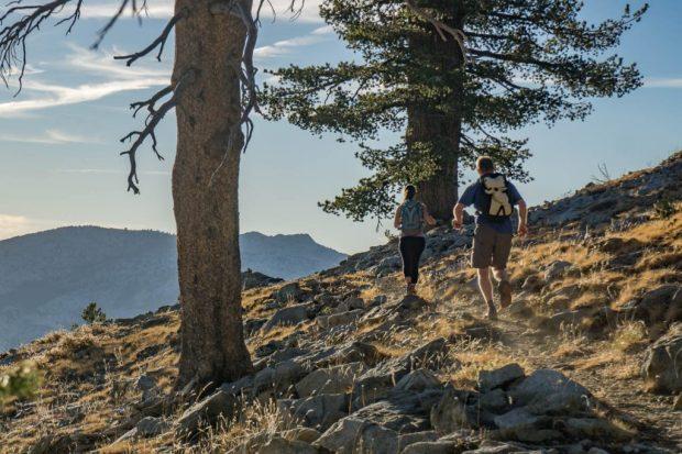 runners heading into sunset near Phipps Pass