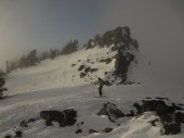 Mike skiing out of the summit bowl and out of the clouds