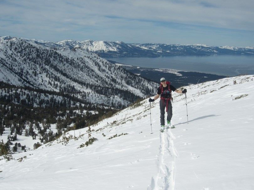 Bennett skinning on the approach to Freel, with Trimmer Peak and Lake Tahoe in the background