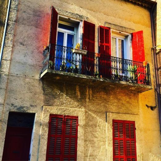 The colors of France glow in the old walls of this building in downtown Brignoles.