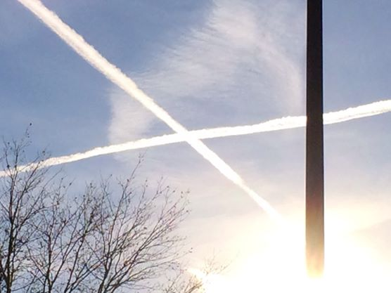 X Marks the Spot.  Airline chemtrails sometimes criss-cross in the sky.