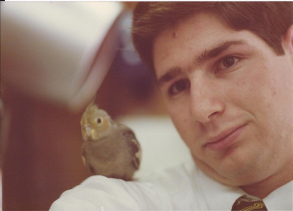 "My first ""selfie"" using a mirror.  I was at a barber shop in Japan when this bird landed on my shoulder.  I took it from an angle"
