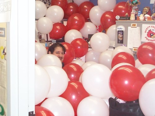 Hiding behind balloons