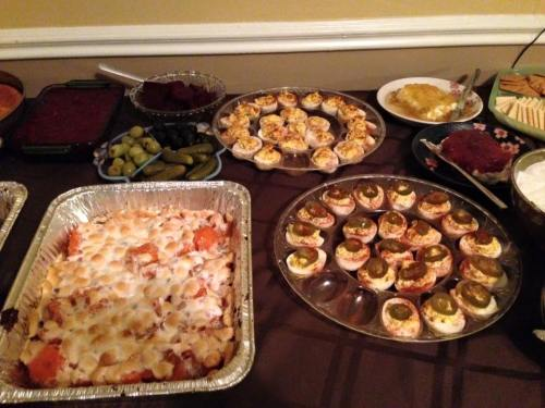 Some of the spread, including spicy deviled eggs with jalapenos