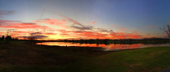 A panorama shot of the lake and skies just before sunrise