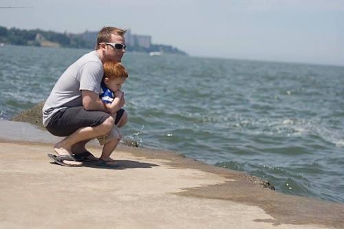 Landen enjoying the ocean with his Dad Adam