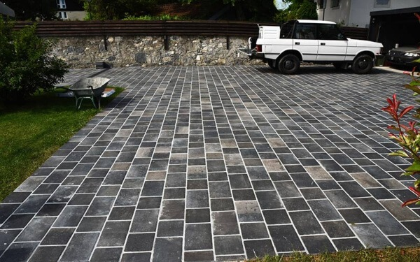 Concrete pavers look more sophisticated than asphalt or gravel