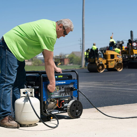 A man using a Westinghouse WGen7500DF, one of the best dual fuel generator