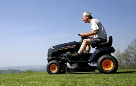 A man riding a garden tractor