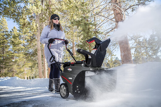 a woman using one of the best snowblower on the market