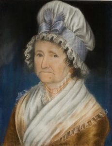 drawing of an older grumpy woman in white cap and orange gown