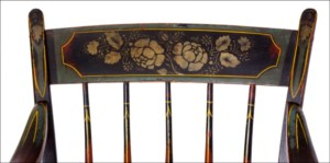 detail of floral gold floral painting on chair crest rail