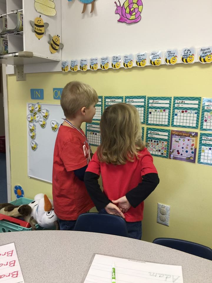 Checking Out Their Sticker Chart for Good Behavior