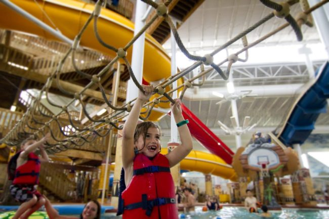 Kalahari guests swing through the indoor waterpark ropes course in Sandusky, Ohio.