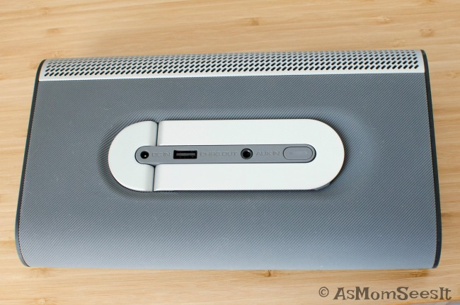 The back of the VIZIO Crave Go speaker has a charging port, kickstand, and aux port.