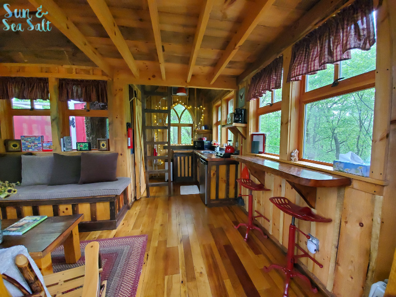 The Little Red treehouse sleeps two people comfortably and has a kitchen with running water