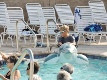Mary Murphy riding the dolphin at the opening of the new swimming pool.