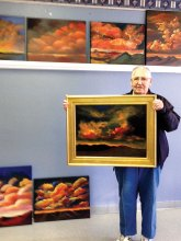Virgil Baker proudly displays his painting from our 'Clouds' class taught by Art Norby.