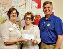 Pictured are Rotarians Terrie Sanders and Steve Perkins presenting a $1,030 check to Ginny Hildebrand, the CEO/President of the United Food Bank. The presentation was made April 7 at Food Bank headquarters in Mesa.