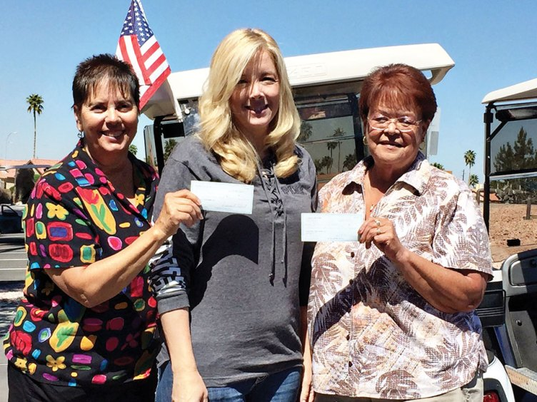 Linda Bengston, Jamie Sistek and Barb Dunbar delivering check to Boots in the House