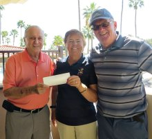 Jerry Lingen receives a check from Bev Launer, Bandit president, and Richard Craig, the Bandit tournament chairman.