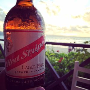 Sundance Vacations Fly Away A Travelers Review Jamaica Enjoying a Red Stripe Beer on the Beach