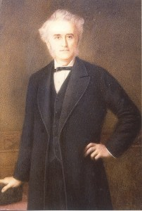 An illustration of John Langdon Down in a black three piece suit with white hair standing with a hand on his hip