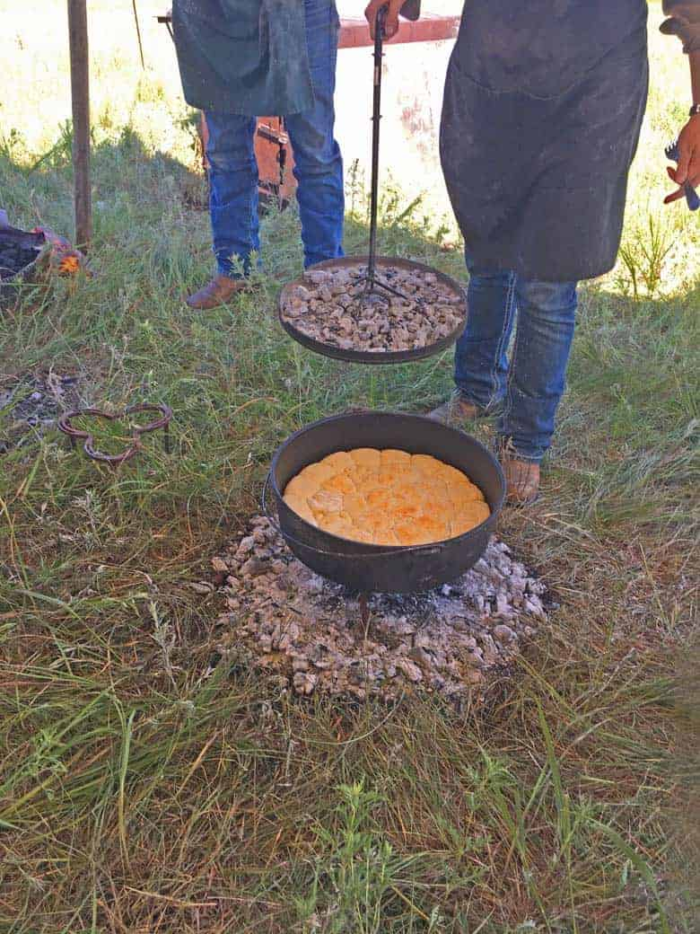 Cooking sourdough biscuits in a cast iron pot on the ranch.